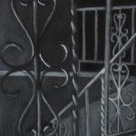 Closeup of wrought iron railing