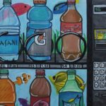 Painting of sports drinks inside a vending maching