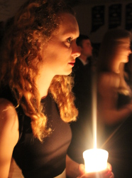 senior girl holding candle